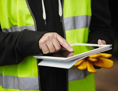construction worker holding tablet GovPilot government software