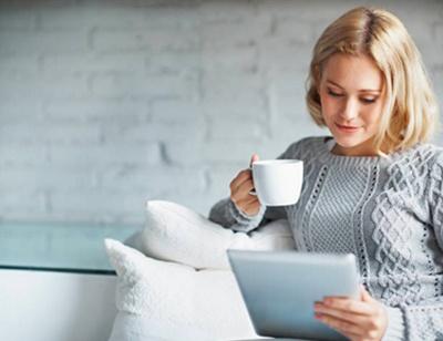 woman with coffee mug GovPilot government software