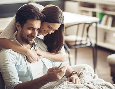 happy couple with phone GovPilot government software