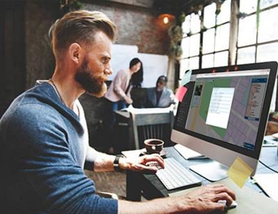 man at desk GovPilot government software